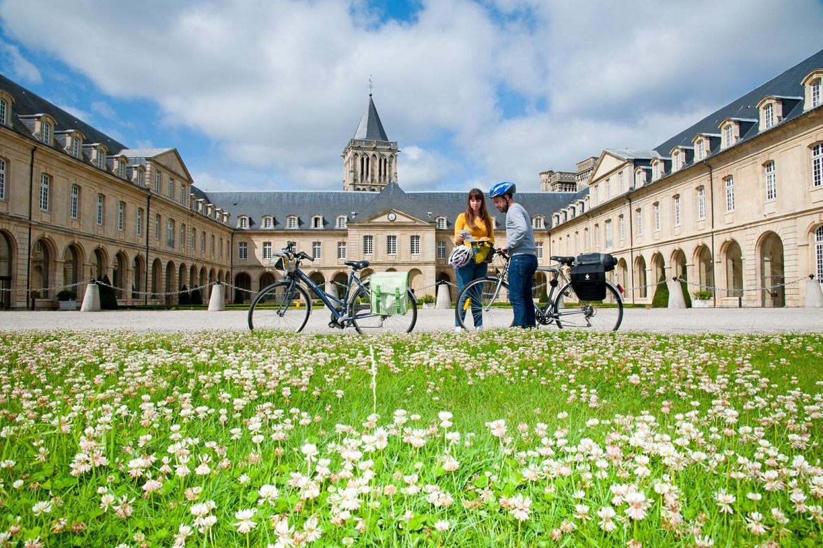 Cyclists front of women abbey in Caen