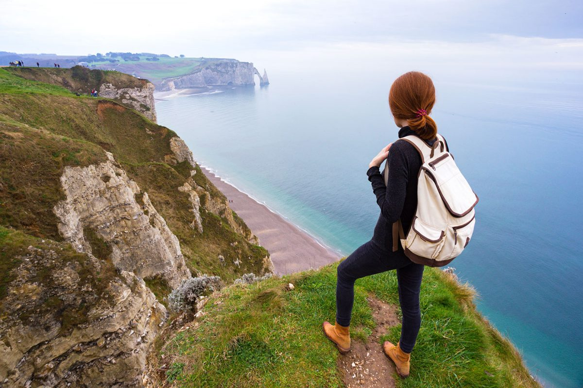 Hiker up the hill in Etretat