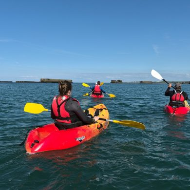 Sea kayaking amid iconic D-Day landmarks